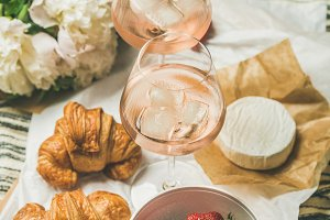 Flat-lay of rose wine, strawberries