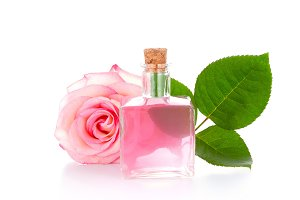 Glass bottle and pink rose