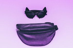 shiny bum bag with cat eye sunglasse