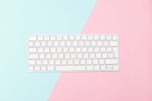 White keyboard on pastel background