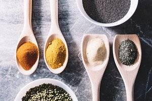 Spices on spoons, chia seeds and gre