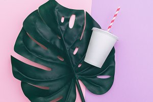 paper cup and palm leaf