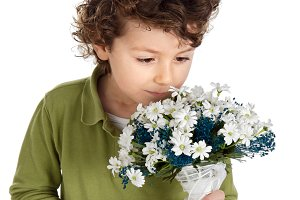 Lovely child with a bouquet