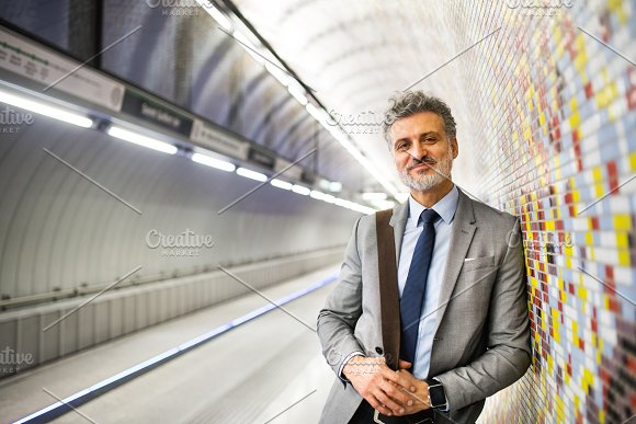 Mature Businessman Waiting On A Metro Station