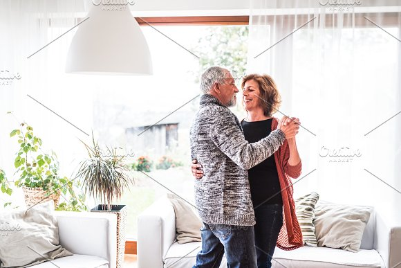 Senior Couple Relaxing At Home Dancing