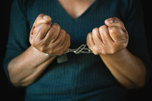 hands of woman and chain