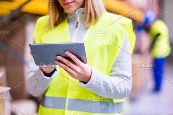 Unrecognizable Woman Warehouse Worker With Tablet