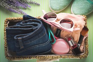 Lady clothes and accessories in basket