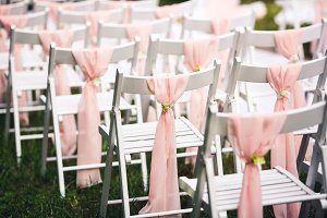 White chairs at the wedding ceremony