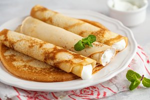 Thin pancakes with cottage cheese