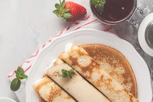 Thin pancakes with jam