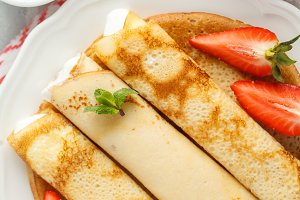 Thin pancakes with strawberry