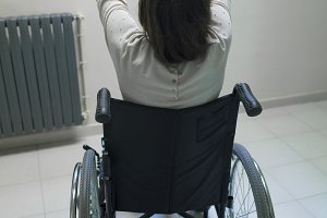 woman in wheelchair and taking photo