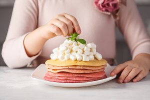 Girl eating pink ombre pancake