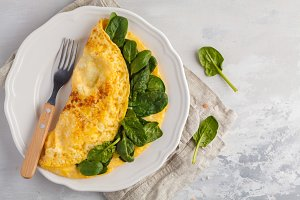 Omelette stuffed with spinach and ch