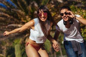 Happy couple doing skateboarding