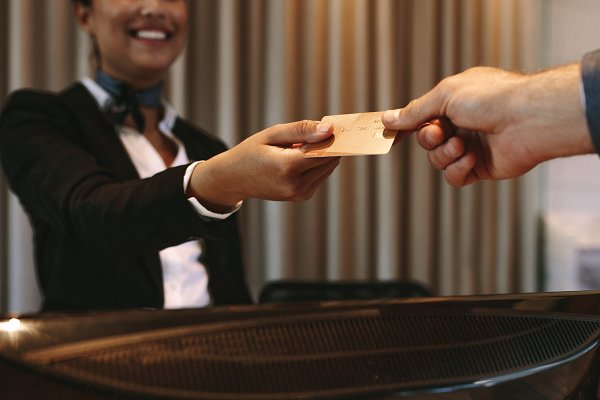Businessman paying for hotel room