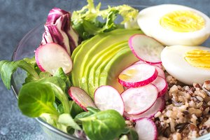 Bowl of wild rice with avocado