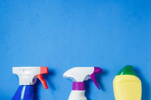 Cleaning Products. Home Cleaning Concept. Blue Background. Place for Typography and Logo. Copy space. Flat Lay Top View