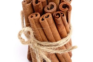 Cinnamon sticks bunch isolated on white background. Top view