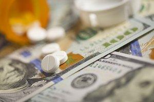 Medicine Pills Scattered on Money