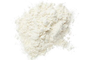 Pile of flour isolated on white background. Top view. Flat lay