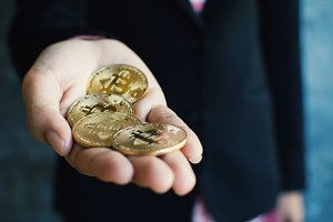 Businesswoman holding bitcoin