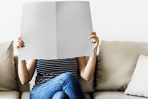 Woman reading newspaper (PSD)