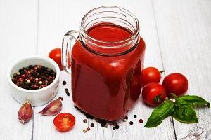 Jars with tomato juice