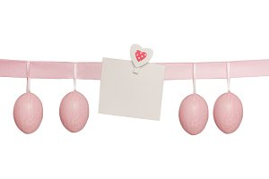 Easter pink hanged eggs, isolated