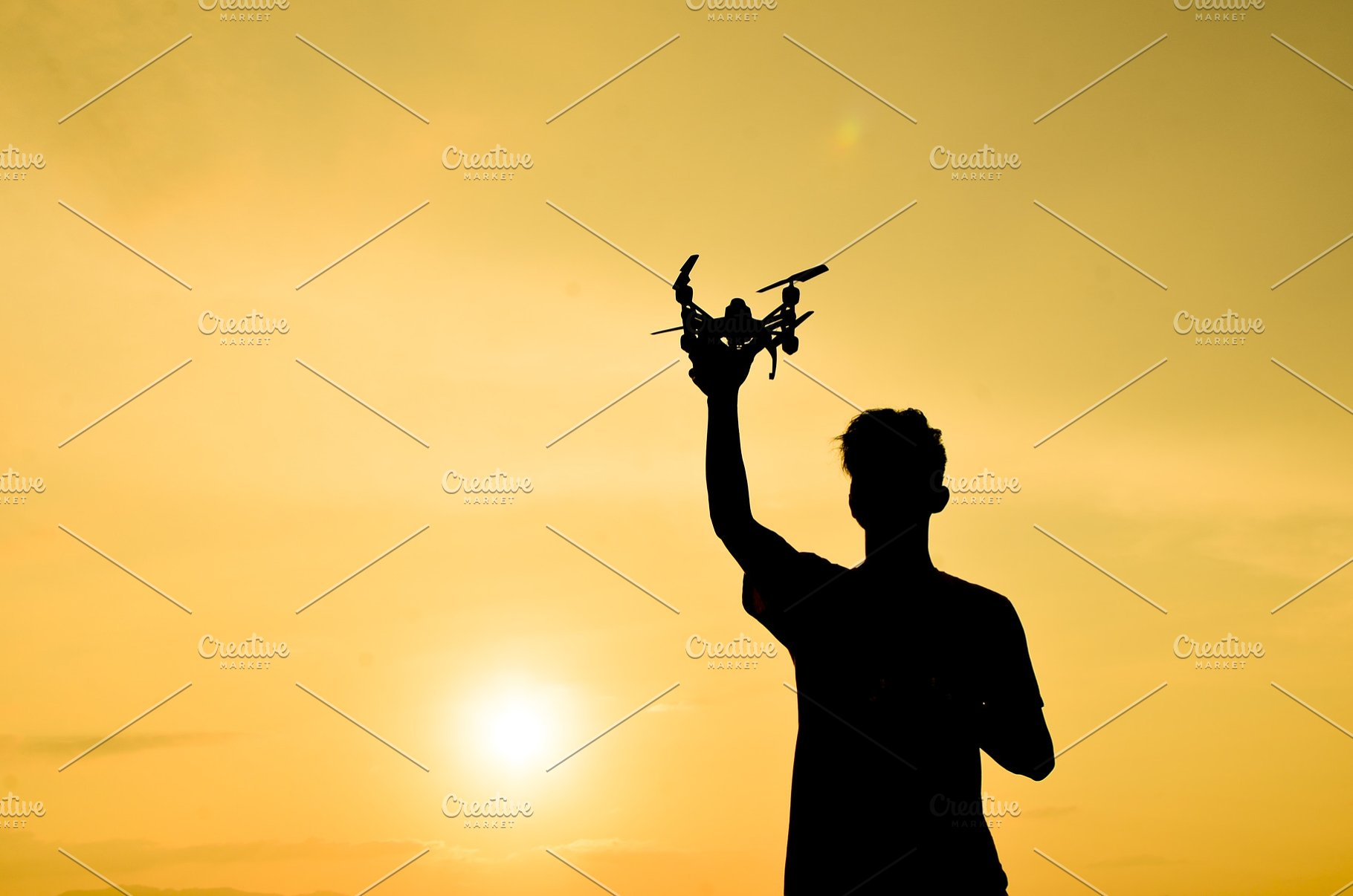 Silhouette of farmer using drone