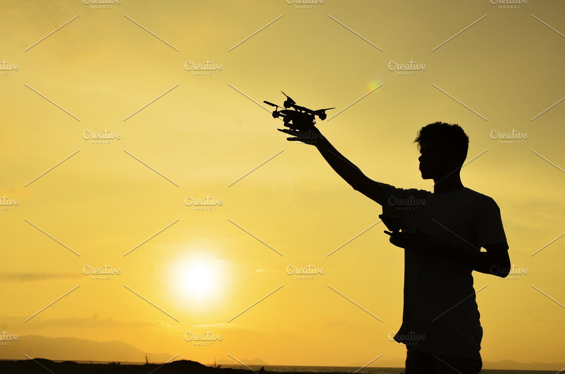 Silhouette of farmer using drone