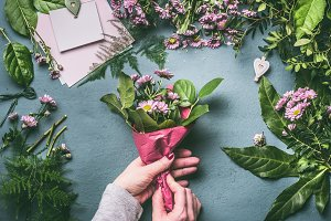 Hands making lovely bouquet