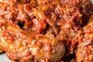 Meat cooked in italian ragu sauce