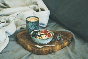 Rice coconut porridge and espresso in bed, square crop