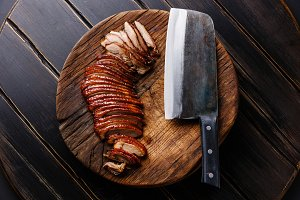 Sliced Peking Duck and cleaver