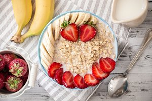 Oatmeal in bowl with fruits