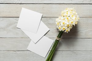 White narcissus flowers and notes
