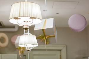 Photo of room with decor, gifts, makarons, chandelier