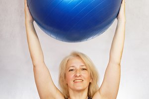 A woman does exercises from pilates at home