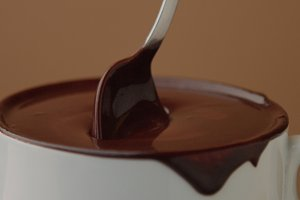 spoon in cup of hot chocolate