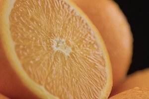 closeup of oranges on black background