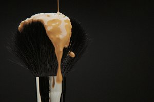 black brush with a liquid foundation