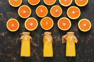 Orange juice and halves of orange
