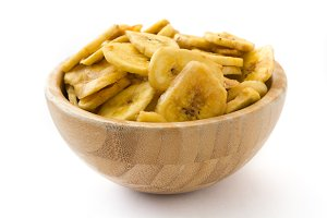 Banana chips in wooden bowl isolated