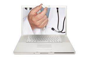 Doctor Handing Pill Through Laptop