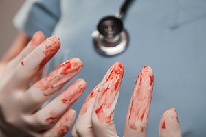 Doctor's Bloody Surgical Gloves
