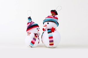 two Snowman on white. Christmas.