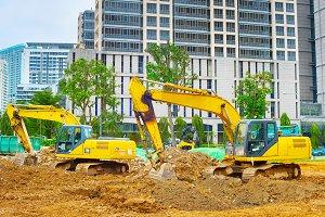 Excavators digging soil