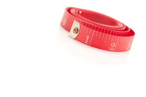 Coiled Red Measuring Tape Isolated